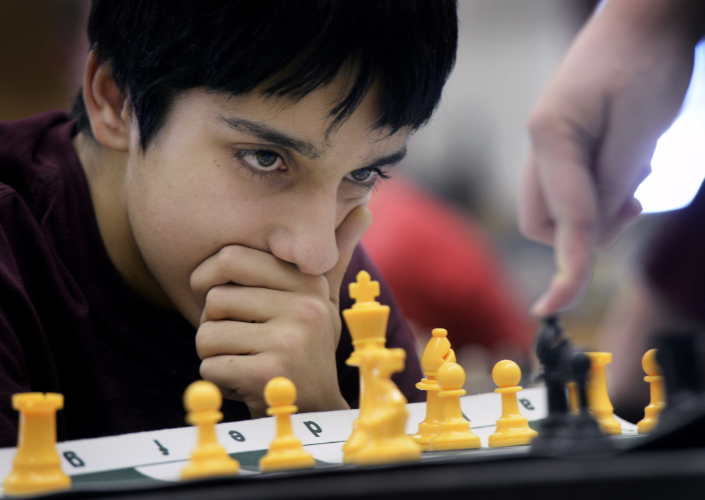 Roman Medina, a sophomore at Cape Elizabeth, carefully watches his opponent's next move during a chess game while practicing with the Cape Elizabeth chess team Monday.