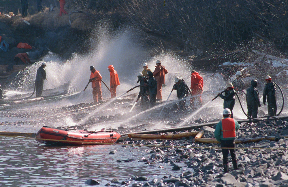 Crews use high-pressure hoses to blast the oil-covered rocks on a beachfront of Naked Island, Alaska, in April 1989. Nearly 25 years after the Exxon Valdez oil spill off the coast of Alaska, some effects linger in Prince William Sound.