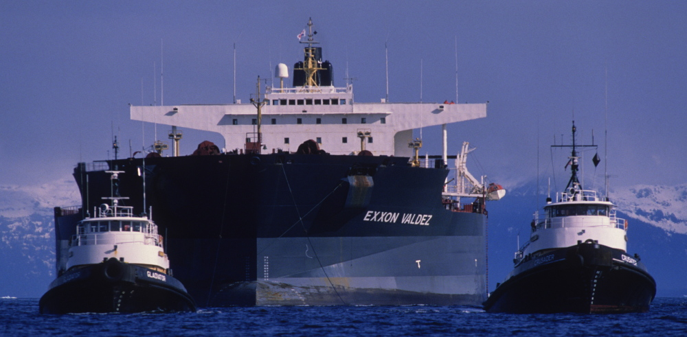 The Exxon Valdez is towed away from Bligh Reef in Alaska's Prince William Sound. Monday marks 25 years since the ship spilled 11 million gallons of oil.