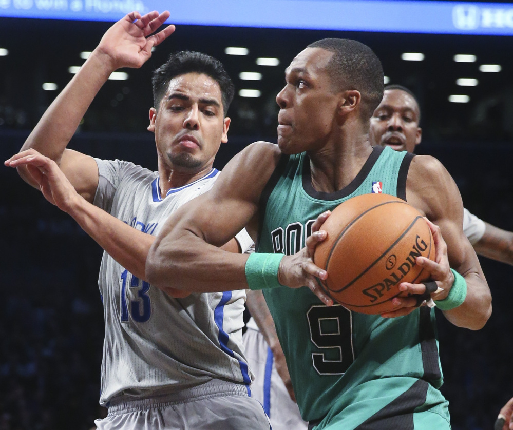 Boston's Rajon Rondo drives against Brooklyn's Jorge Gutierrez during second-half action of Friday's game in New York, a 114-98 win by the Nets.