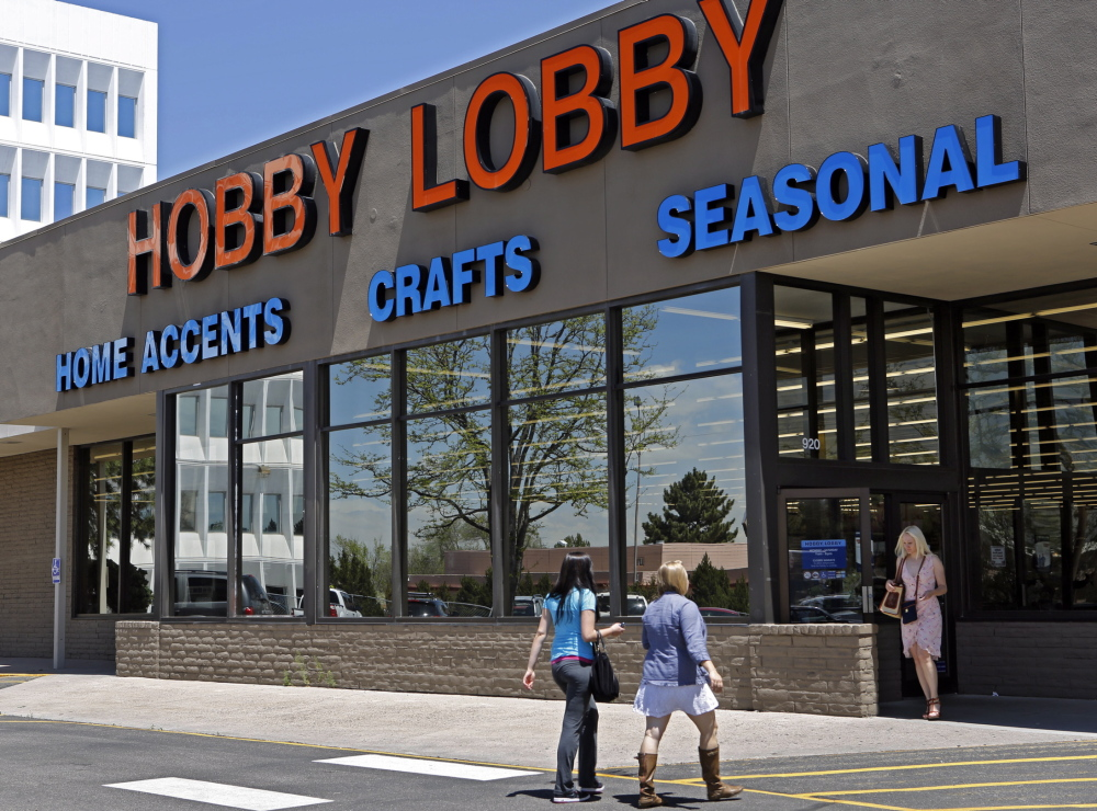 Customers visit a Hobby Lobby store in Denver last May. The chain wants an exemption from a federal health care law requirement that it offer employees health coverage that includes access to the morning-after pill.