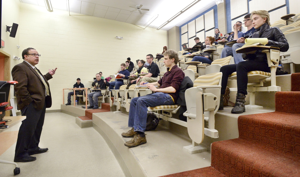 Professor Ronald Schmidt teaches a political science class at the University of Southern Maine in Portland. Planned budget cuts that would raise the faculty-to-student ratio are drawing opposition from those who say academics and USM's image would suffer.