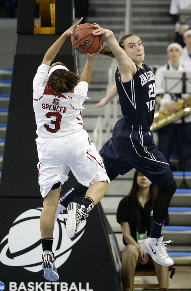 BYU's Lexi Eaton, right, blocks a shot by North Carolina State's Miah Spencer during the first half of a first-round game in the NCAA women's college basketball tournament on Saturday.