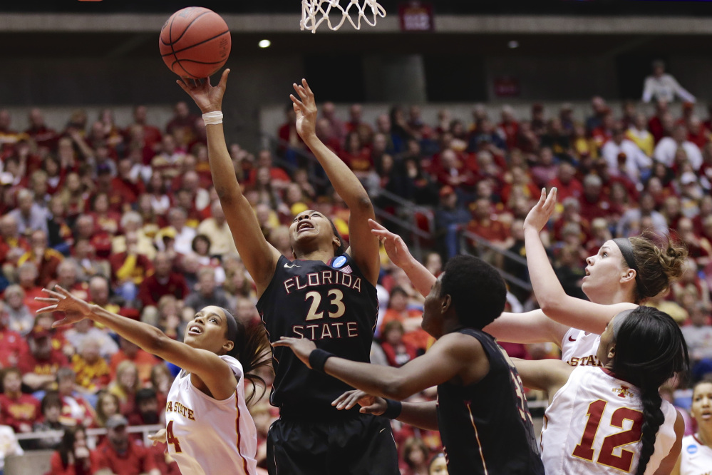 Florida State's Ivey Slaughter (23) shoots against Iowa State's Nikki Moody, left, Hallie Christofferson, right rear, and Iowa Seanna Johnson (12)in the second half of a first-round game in the NCAA women's college basketball tournament in Ames, Iowa, Saturday.