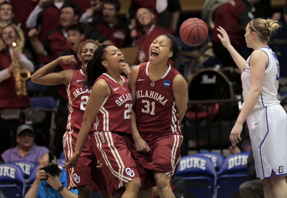Oklahoma's Portia Durrett (31) celebrates with teammates Sharane Campbell, left, and Gioya Carter, middle, while DePaul's Megan Podkowa recovers the ball after Durrett scored and drew a foul that eventually pulled the Sooners within three points of DePaul during the second half of their first-round game in the NCAA basketball tournament in Durham, N.C., Saturday.