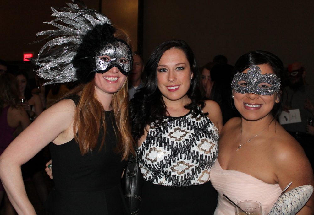 Lesley Clunie, left, Victoria Hartig of the University of New England and Belle Bocal get into the spirit of the League event.