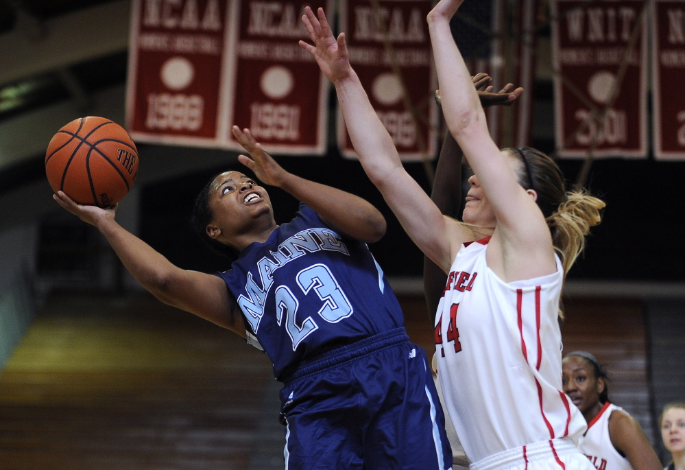 Maine's Ashleigh Roberts goes up for a shot against Fairfield's Katie Cizynski during a second-round game Sunday in the Women's Basketball Invitational at Fairfield, Conn. Roberts ended her career with 24 points in a 63-50 defeat.