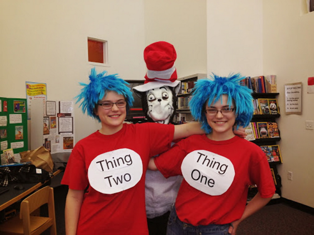 Wells-Ogunquit Community School District students Bethany and Sarah Berger dressed as The Cat in the Hat characters Thing One and Thing Two during a recent Reading Celebration Day at Wells Elementary School. At center, dressed as the Cat in the Hat is Nancy Cotty.