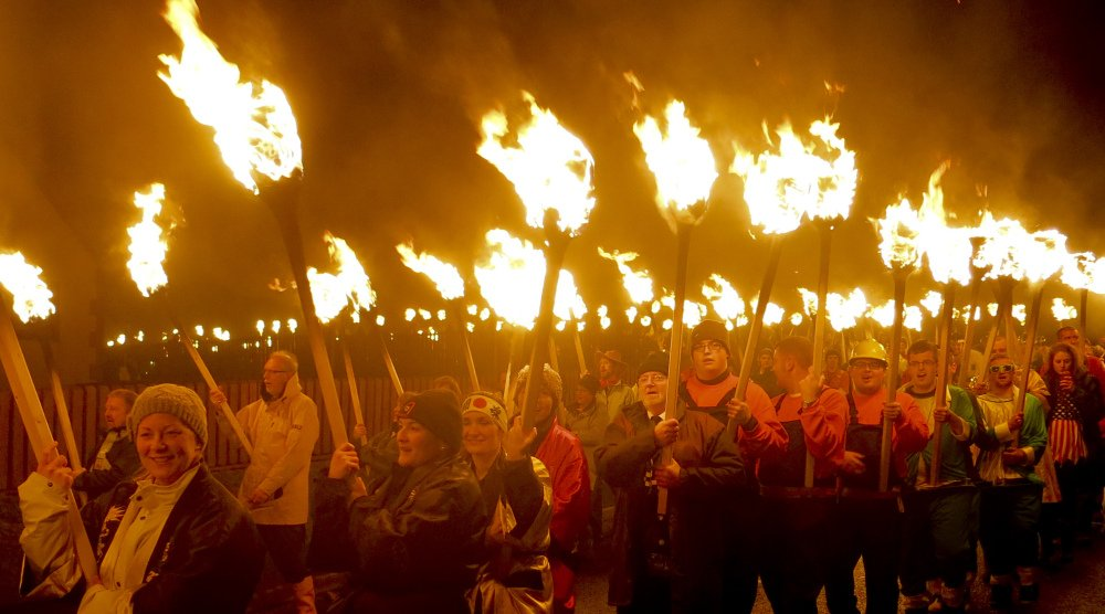 Locals dressed as Vikings carry torches in the annual Up Helly Aa, the Viking fire festival in Gulberwick, Shetland Islands, north of mainland Scotland. They live in the remote archipelago where many claim descent from Scandinavian raiders.