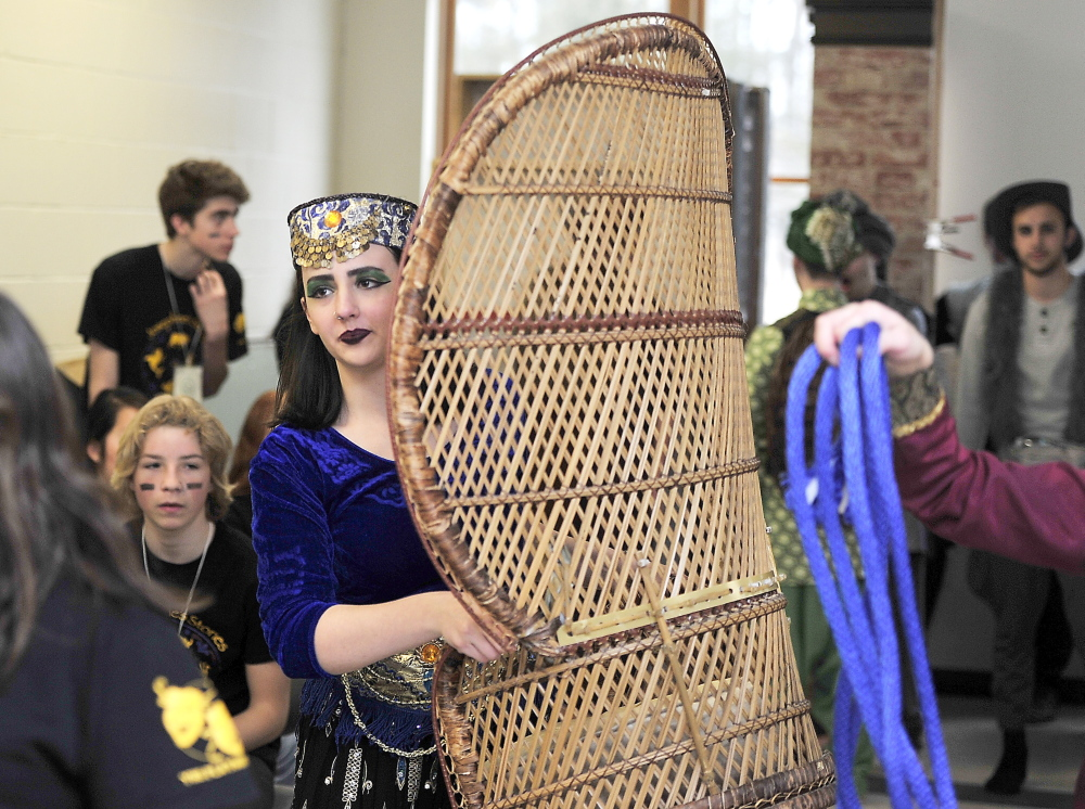 "Senior Amelia French, who adapted Rudyard Kipling's ""Just So Stories"" into a one-act play, carries a prop Saturday at the state drama festival in Yarmouth."