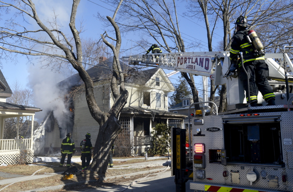 Portland firefighters battle a house fire at 38 Columbia Road in Portland on Monday.