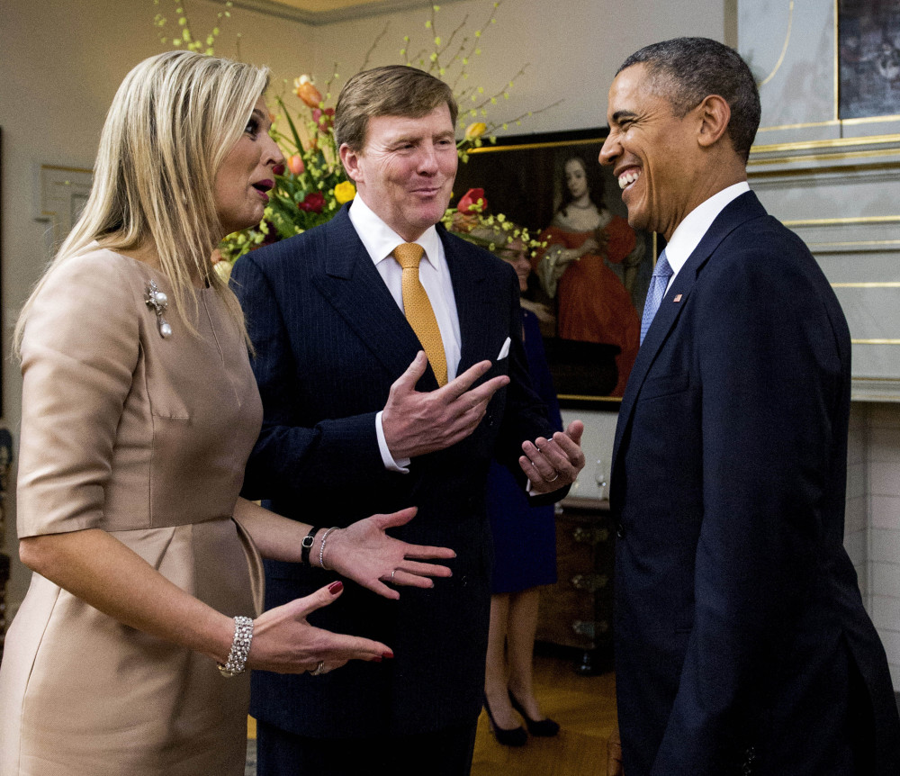 Dutch Queen Maxima and King Willem Alexander greet U.S. President Barack Obama in The Hague, Netherlands on Monday. The president also attended a G-7 summit arranged to deal with Russia's annexation of Crimea.