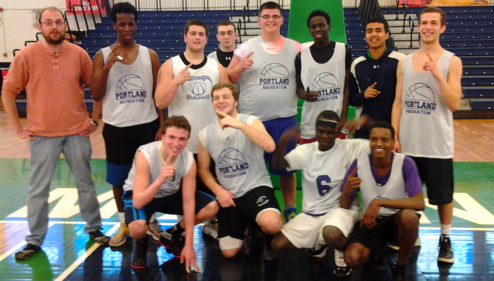 Riverton Rec successfully defended its Greater Portland High School Rec Basketball League championship on March 12 at the Portland Expo. Team members, from left to right: Front row – Ben Peterson, Mike Thurston, Eddy Koma and Ismail Abdi; Back row – Coach Jason Bradley, Jamal Ali, Adam Amabile, Allen Seyler, Drew Waterhouse, David Matthew, King Cua and Caleb Angell.