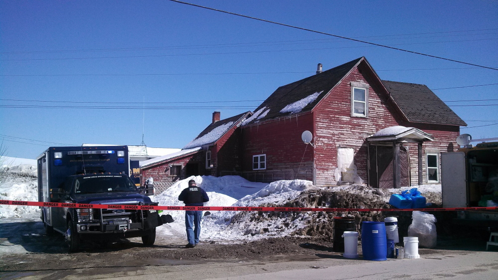 Police investigate a suspected meth lab in Hodgdon on Tuesday.