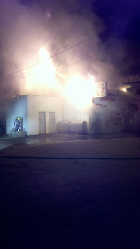 Staff photo by Andy Molloy Early morning fire destroys Webb's Store in Randolph.