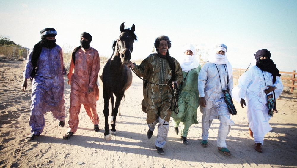 Tinariwen's music is influenced by their region in Africa and by Western musicians like Jimi Hendrix.