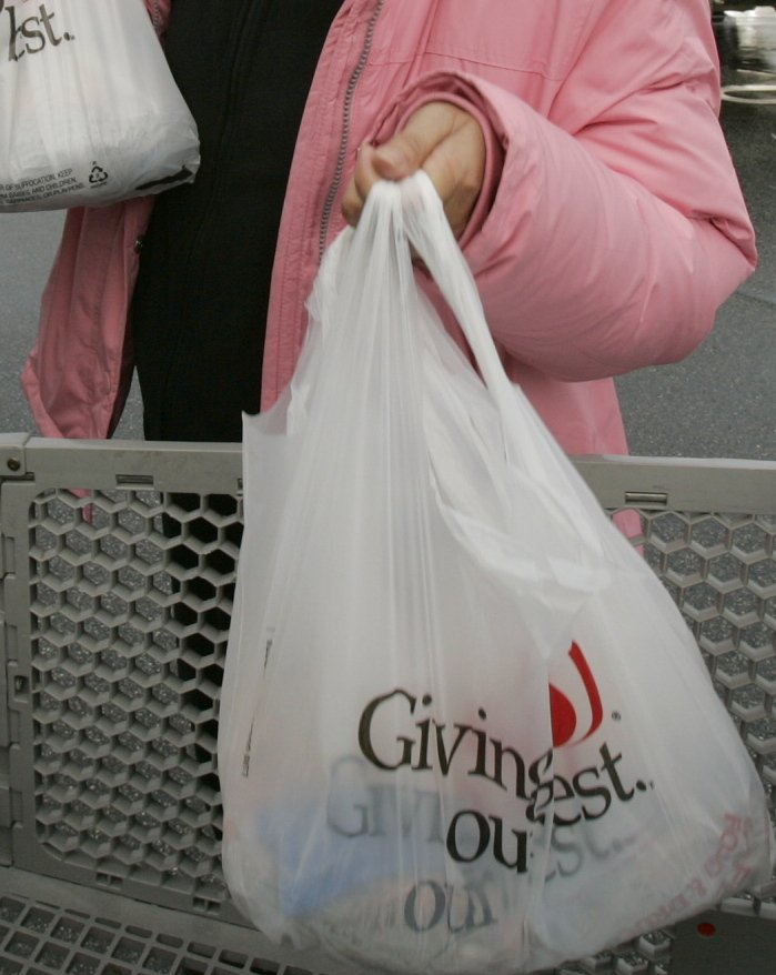 One reason for imposing a fee on plastic bags is to encourage shoppers to supply their own bags.