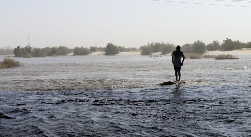 A man crosses the water Wednesday in what has been for decades a dry riverbed in San Luis Rio Colorado, Mexico. Seven U.S. and two Mexican states rely on the Colorado River.