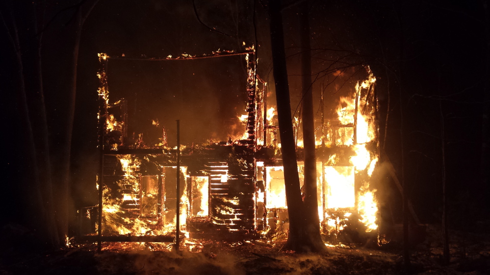 Fire engulfs a house on Lovers Lane in New Gloucester early Thursday morning. Emergency personnel from six towns were involved in battling the blaze.