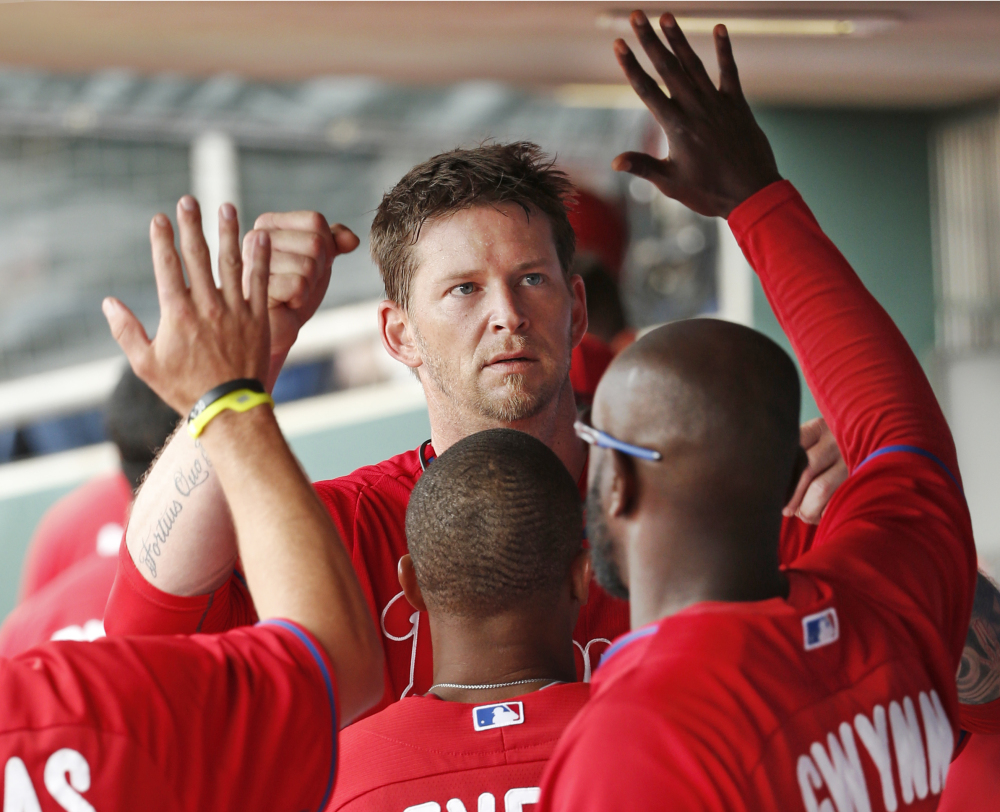 A.J. Burnett of the Philadelphia Phillies returns to the dugout Thursday after allowing one run over six innings in a 3-0 loss to the Toronto Blue Jays at Clearwater, Fla.