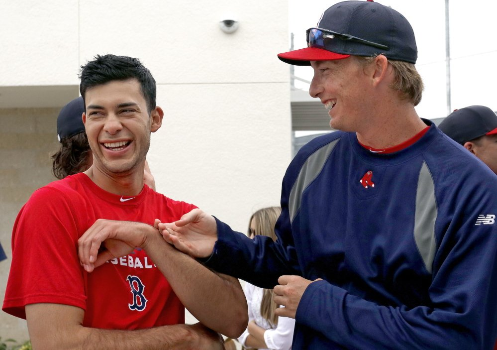 Opposites attract, and for Noe Ramirez, left, and Henry Owens, who are both expected to pitch for the Portland Sea Dogs this season, the attraction has made them close friends as they push for spots with the Boston Red Sox.