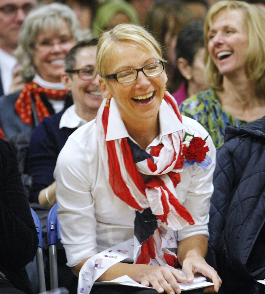 Ilze Apine of Freeport, originally from Latvia, smiles during the naturalization ceremony at the Middle School of the Kennebunks in Kennebunk on Friday.