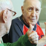 Twin brothers Lawrence Binette, left, and Maurice Binette give each other a thumbs-up on Thursday at an early 100th birthday party at the Maine Veterans' Home in Augusta. They were born April 5, 1914, in Augusta .