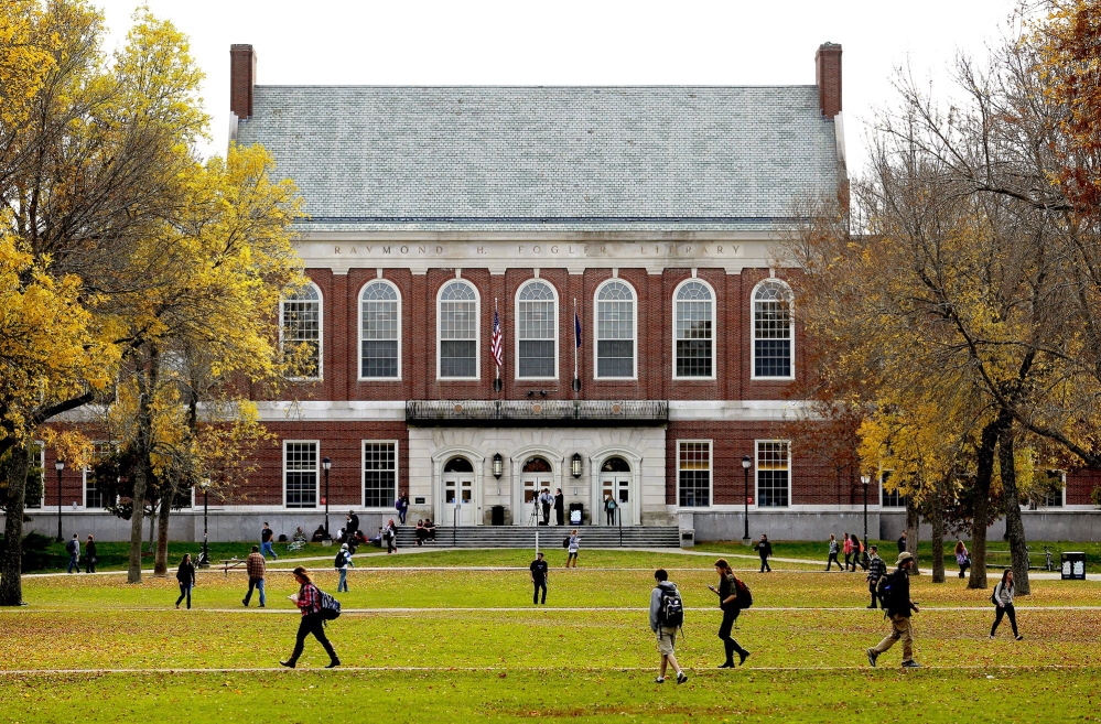 Students and faculty move through the mall at the University of Maine on a fall afternoon.