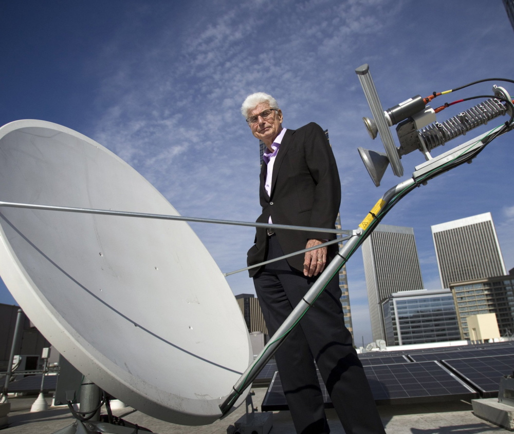 Randy Blotky, CEO of the Digital Cinema Distribution Coalition, stands by a satellite dish on the roof at the AMC Century City 15 theater in Los Angeles.