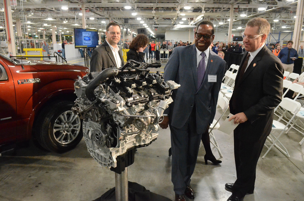 Joe Hinrichs, Ford president of The Americas, right, talks with Jimmy Settles, UAW vice president, at the Lima Ford Engine Plant in Lima, Ohio. UAW's membership grew slightly last year.