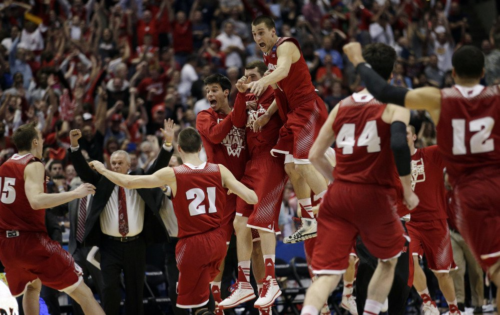 Wisconsin players react as time runs out in overtime in a regional final NCAA college basketball tournament game, Saturday, March 29, 2014, in Anaheim, Calif. Wisconsin won 64-63 in overtime.