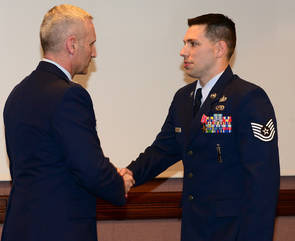 Air Force Sgt. Matt Bolduc of Oakland, right, shakes hands with Air Force Col. Jeff Hurlbert earlier this month.