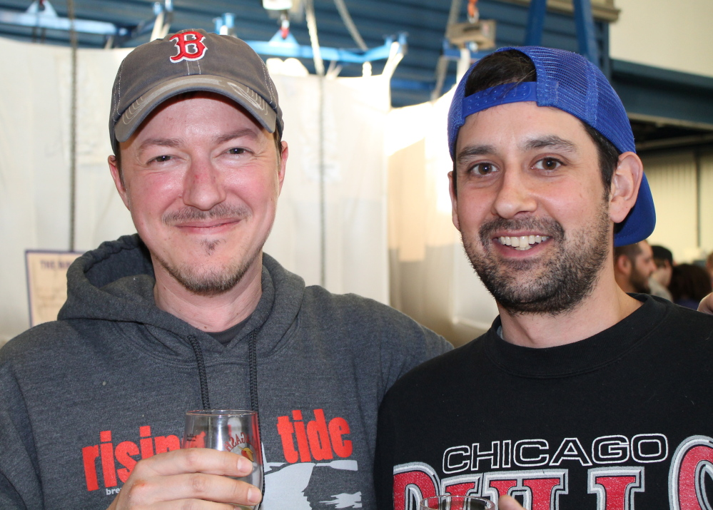 Sean Spence of Rising Tide Brewing, left, and Jack Perreault, of Allagash Brewing toast the new beer, Allagash Saison.