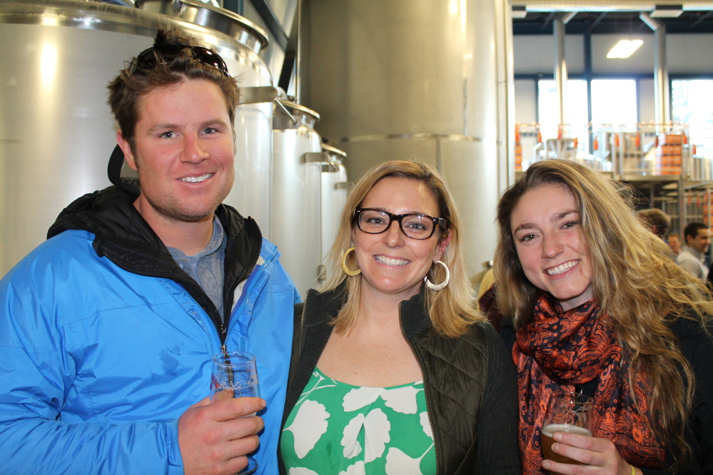 Scott Werner of Falmouth joins Mariah Nelson of Allagash Brewing Co. and Anna Vallely of Cape Elizabeth at the launch party at the brewery in Portland.
