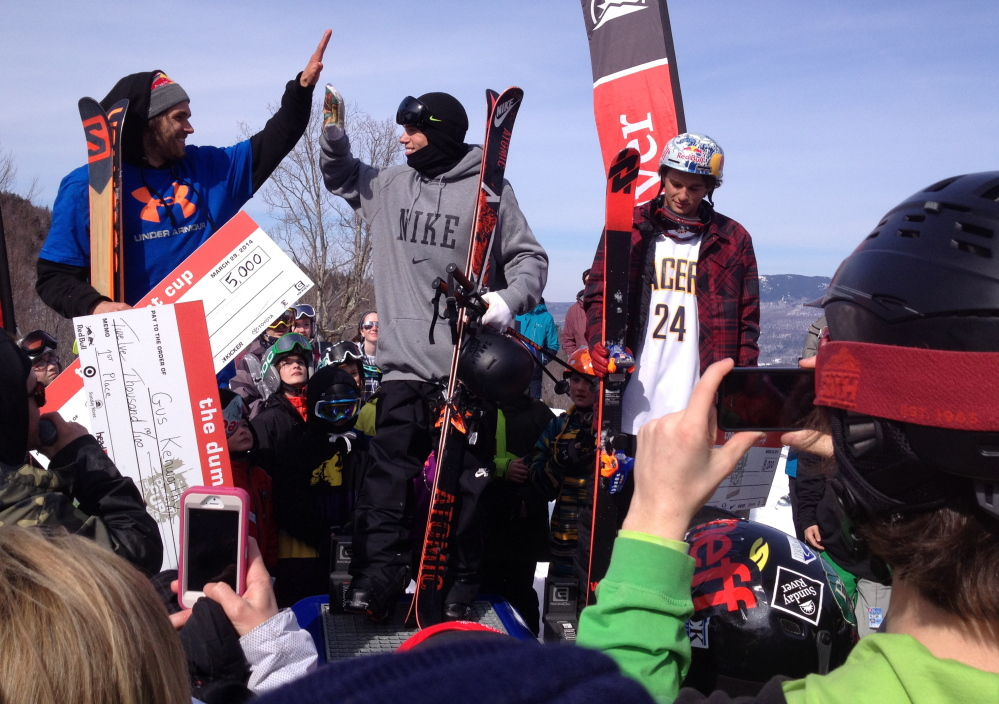 Gus Kenworthy, who won the Dumont Cup, gets a high-five Saturday from the third-place finisher, Bobby Brown. Nick Goepper took second.