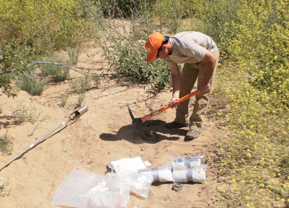 Joseph Daniel collects soil in Southern California. The federal government sent students and scientists to more than 4,800 places across the nation to collect soil that was analyzed for its composition. The results are now highly sought after by researchers in a wide variety of fields.