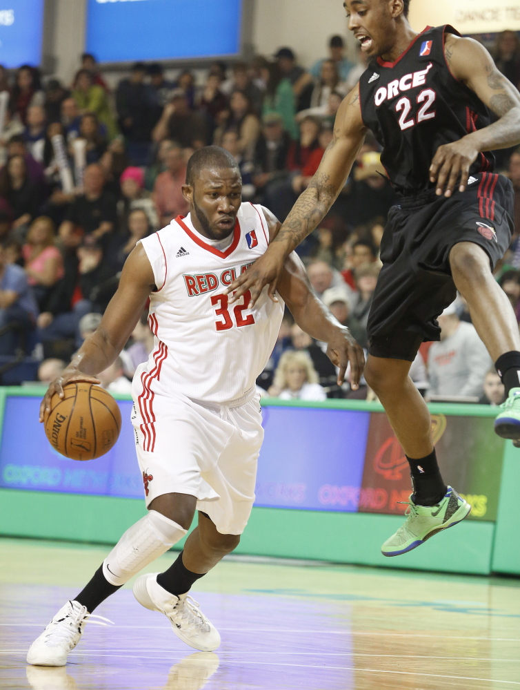 Red Claws forward Julian Mavunga gets Anthony Mason Jr in the air with a fake and drives to the basket Sunday during Maine's 113-110 loss to the Sioux Falls Skyforce at the Portland Expo.