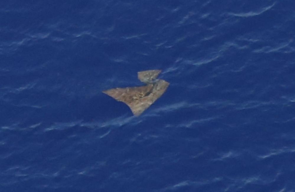 An object floats in the southern Indian Ocean on Saturday in this picture taken from a Royal New Zealand Air Force P-3K2 Orion aircraft searching for missing Malaysia Airlines Flight 370.