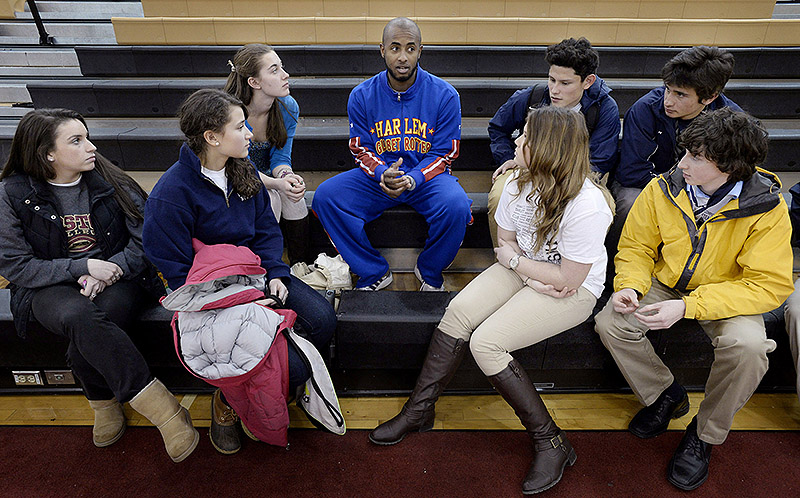 Dizzy Grant of the Harlem Globetrotters shares an anti-bullying message Thursday with Portland and Deering High students at the SMAA Sportsmanship Summit at Scarborough.
