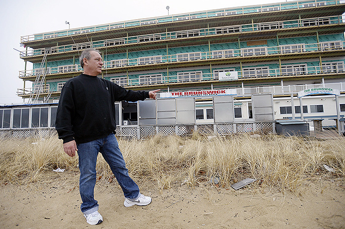 Tom Lacasse, manager of the bar, restaurant and patio at the Brunswick in Old Orchard Beach, stands outside the waterfront business in January 2014. A newly approved bill scales back big flood-insurance premium increases caused by a reform law that was passed two years ago.