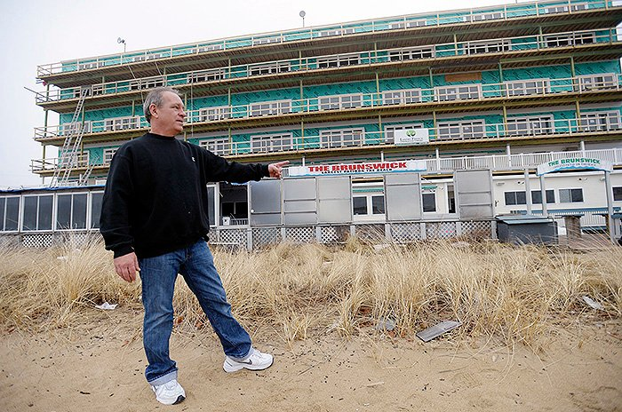 In this January 2014 file photo, Tom Lacasse, manager of the bar, restaurant and patio at the Brunswick in Old Orchard Beach, stands outside the waterfront business. He worries that new flood maps could hurt the business by causing a steep increase in flood insurance premiums.