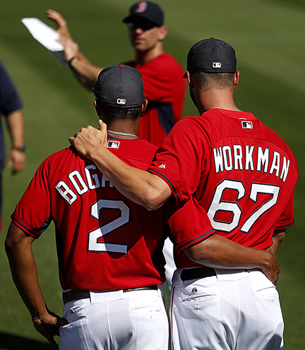 Xander Bogaerts and Brandon Workman are a pair of brothers in arms, as both moved up through Double-A Portland on their way to the major leagues. Here at spring training, they listen to a trainer in a warm-up session before an exhibition game at JetBlue Park.