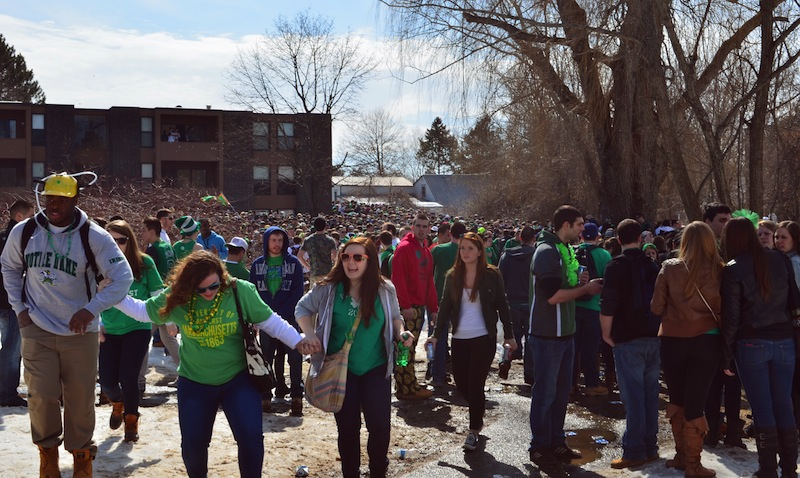 """People gather for the pre-St. Patrick's Day """"Blarney Blowout"""" near the University of Massachusetts in Amherst on Saturday."""