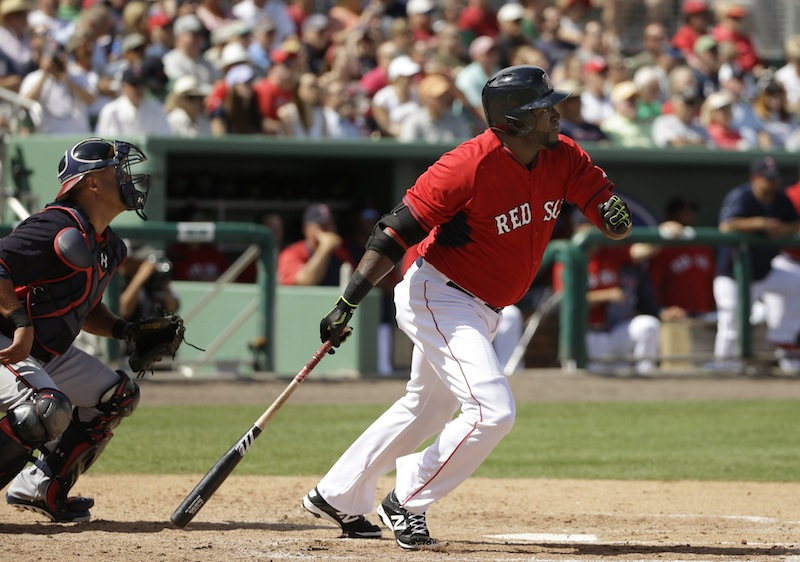 Boston Red Sox designated hitter David Ortiz watches the flight of his double, in front of Atlanta Braves catcher Gerald Laird during an exhibition game Friday in Fort Myers, Fla. The Red Sox won 4-1.