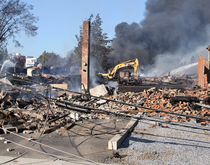 This July 2013 file photo provided by Surete du Quebec shows smoldering debris from a runaway train in Lac-Megantic, Quebec, Canada. Parties who believe they have a right to any proceeds from the liquidation of the bankrupt Montreal, Maine & Atlantic Railway have until mid-June to file claims. MM&A filed for bankruptcy right after the deadly Quebec disaster.