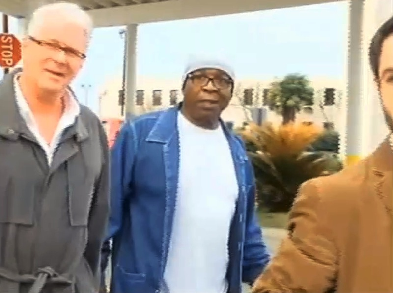 In this frame grab from video provided by WAFB-TV 9, Glenn Ford, 64, center, walks out of a maximum security prison, Tuesday, March 11, 2014, in Angola, La., after having spent nearly 26 years on death row. Ford walked free Tuesday evening hours after a judge approved the state's motion to vacate his murder conviction in the 1983 killing of a jeweler. State District Judge Ramona Emanuel on Monday took the step of voiding Ford's conviction and sentence based on new information that corroborated his claim that he was not present or involved in the murder.