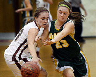 McAuley's Allie Clement, right, received the Miss Maine Basketball Award on Friday.