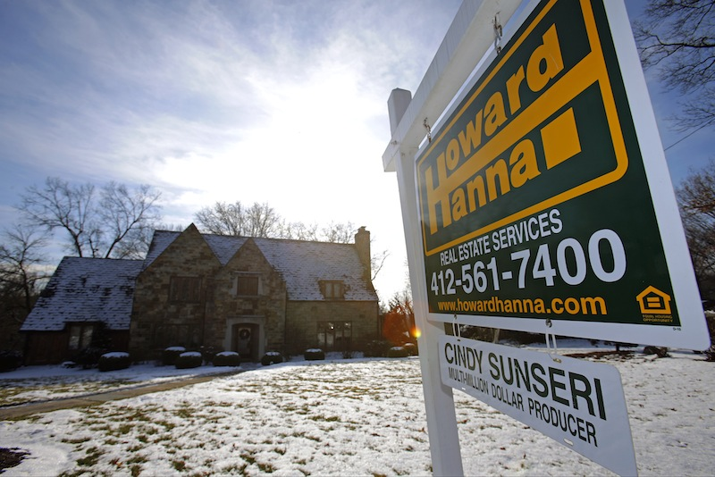 In this Thursday, Jan. 9, 2014, photo, a for-sale sign hangs in front of a house in Mount Lebanon, Pa. A plan to phase out government-controlled mortgage giants Fannie Mae and Freddie Mac and instead use mainly private insurers to backstop home loans has advanced in Congress.