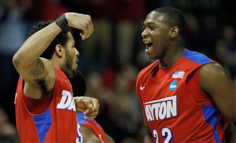 Dayton's forward Devin Oliver, left, and Kendall Pollard celebrate a play against Stanford in their regional semifinal game at the NCAA college basketball tournament Thursday in Memphis, Tenn.