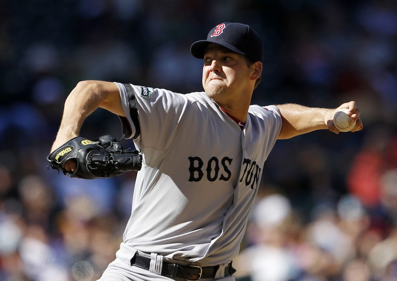 Boston Red Sox pitcher Rich Hill throws against the Seattle Mariners in Seattle in September 2012. Hill reported to Boston's camp Thursday, following the Feb. 24 death of his son Brooks, who was less than 2 months old.